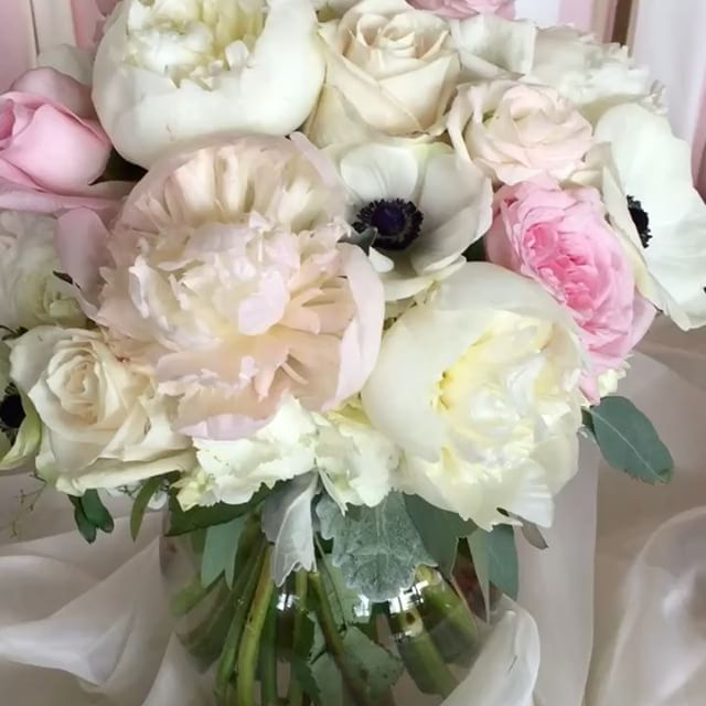 Peonies and anemones highlighted Nicole's wedding bouquet. A picture perfect couple, venue and day.